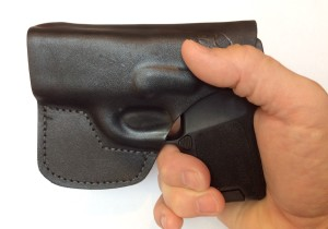 Holster allows for a good purchase, without crowding out the middle finger.