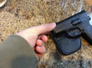 Use your fingers to mold the leather around the end of the gun.