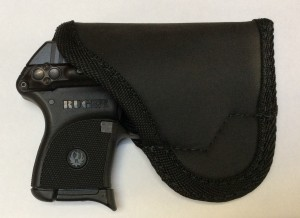 Reverse of the SM-2 Sticky Holster with the LCP in place. I think this is the best solution for LCP pocket carry if you DO NOT have the LaserLyte in place. With it, the fit is on the snug side and you could find yourself wearing the wrong king of protection on a fast draw.